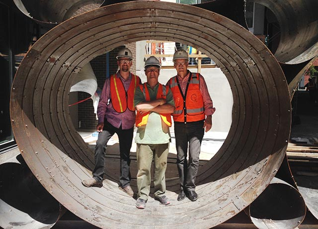 The scale of the sculpture is so large, that three of the installation crew members could fit inside just one of the loops!