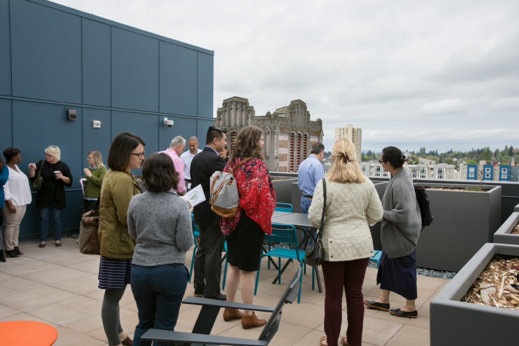 Photo of attendees of the ground breaking ceremony gathered on the roof deck at Arbora Court