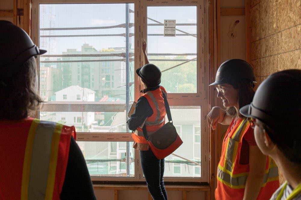 tour attendee at Solis checks out the operable windows
