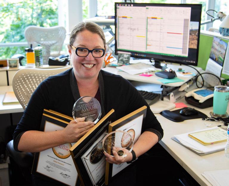 Photo of Elizabeth Holland holding Weber Thompson PSMJ Awards