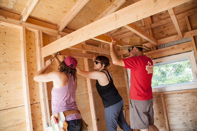 Weber Thompson staff working on the interior of the Tiny House.